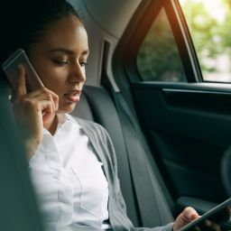 stress woman with technology in car